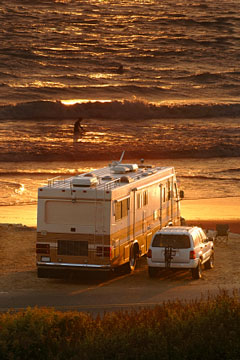 rving - rv on beach at sunset
